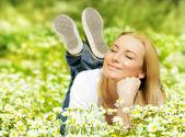 Beautiful female enjoying flower filed — Stock Photo