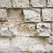 Foto de Stock  : Old wall made of sandstone