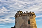 Home castle at sunset on a sky with clouds — Stock Photo
