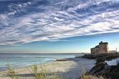 Old castle by the sea with a beautiful sky — Stock Photo