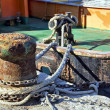 Stock Photo: Boat moorings oxidized in fishing port