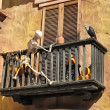 Skeleton climbing a balcony with a vulture — Stock Photo