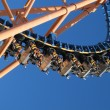 Moving roller coaster with blue sky — Stock Photo