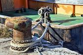 Boat moorings oxidized in a fishing port — Stock Photo