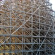 Structure supports and wooden roller coaster — Stock Photo #10693453