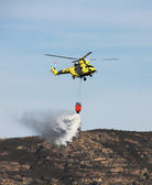 Fire fighting helicopters fire on the mountain — Stock Photo