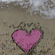 Love and heart in the beach sand — Stock Photo