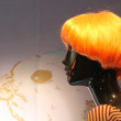 Female mannequin with very showy orange wig — Stock Photo