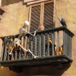 Skeleton climbing a balcony with a vulture — Stock Photo #9158343
