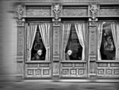 Elderly in the windows of an old casino — Stock Photo