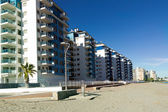 Apartment buildings typical tourist on the beach of the Mediterr — Stock Photo