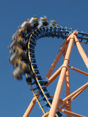 Moving roller coaster with blue sky — Stockfoto