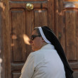 Madrid- AUG 15: Catholic nun talking on the street on Aug 15, 20 — Stock Photo