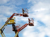 Different types of cranes with basket — Stock Photo