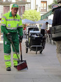 Sweeper cleaning service worker of the City of Madrid — Stock Photo