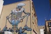 Giant robot graffiti on the facade of a house — Stock Photo