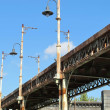 Stock Photo: Old bridge of iron oxidized with street lamps