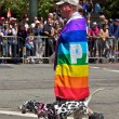 Guy At Gay Pride Wrapped In Rainbow Flag With Three Legged Dog — Stock Photo
