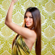 Asian Indian brunette girl with long hair dancing — Stock Photo