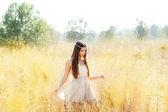 Asian indian woman walking in golden dried field — Stock Photo