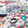 Jewelry in a bargain market spread - Stock Photo