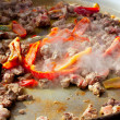 Paella from Spain first steps cooking big pan — Stock Photo