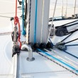 Stock Photo: Detail of sailboat mast bottom with ropes