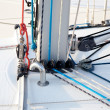 Detail of sailboat mast bottom with ropes - Stock Photo