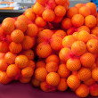 Oranges fruit on market net bags - Stock Photo