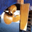 Brass boat propeller and steering — Stock Photo