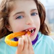 Blue eyes little girl eating churros fried crullers — Stock Photo #10583151