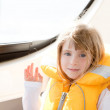 Blond kid girl with marine yellow lifesaver jacket — Stock Photo