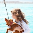 Brunette kid girl with dog on the sea — Stock Photo #10583273