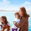 Mother and daughter sister girls with dog on the sea — Stock Photo