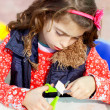 Little kid girl working at school doing workshop — Stockfoto
