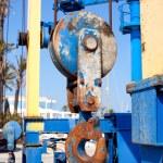 Boats crane hook pulley detail on marina — Stock Photo #10583326
