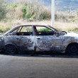 Burned out car in street — Stock Photo #10583338