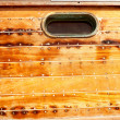 Boat oval porthole in wooden hull — Stock Photo