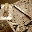 Cement mortar dirty tools like trowel - Stock Photo