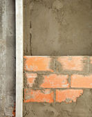 Brickwall construction and mortar cement plaster — Stock Photo