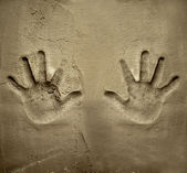 Both hands print on cement mortar wall — Stock Photo