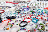 Jewelry in a bargain market spread — Stock Photo