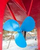 Blue sailboat propeller in a red hull — Stock Photo