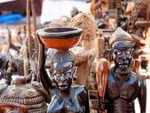 African handcraft dark wood carved figures — Stock Photo