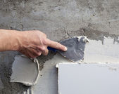 Construction spatula trowel in tile work with mortar — Stock Photo