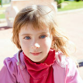 Blond little girl blue eyes portrait in pink — Stock Photo