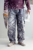 Construction plaster plaster man dirty trousers — Stock Photo