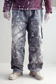 Hands dirty trousers of plastering painter man — Stock Photo