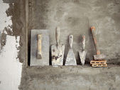Aged construction cement mortar used tools — Stock Photo