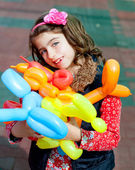 Balloon twisting art children happy — Stock Photo